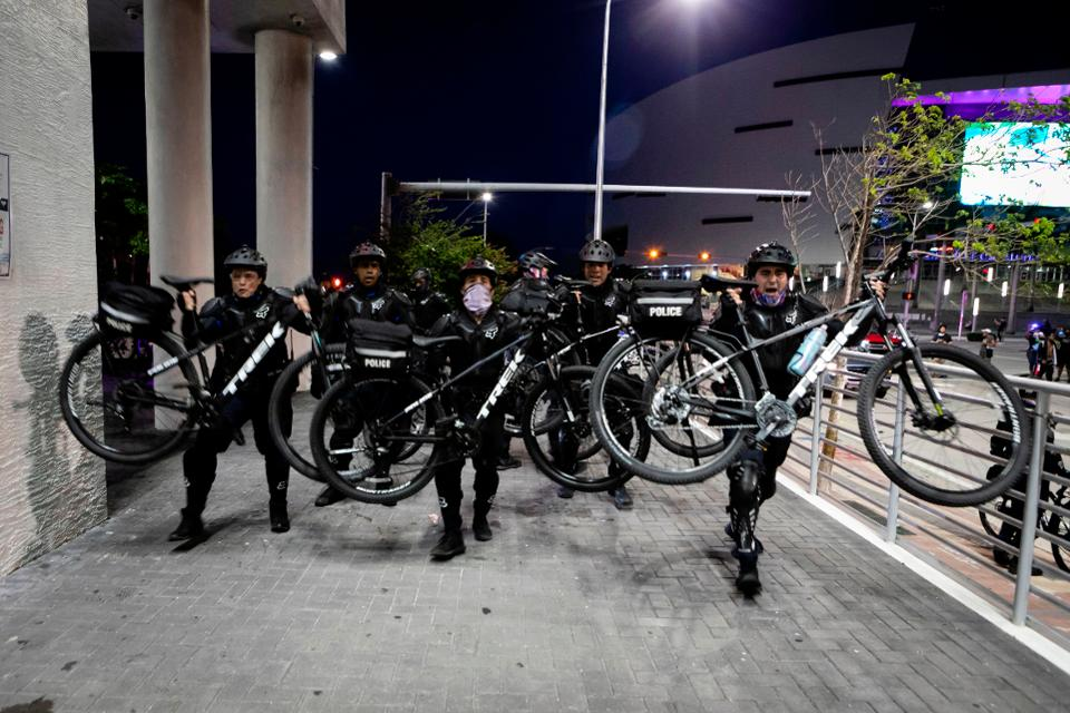 Cops using their bicycles as crowd control machines.